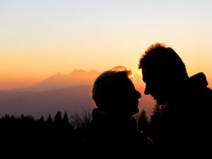 two people with sunset