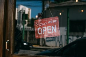 Photo-Open-For-Business-Sign-In-Window